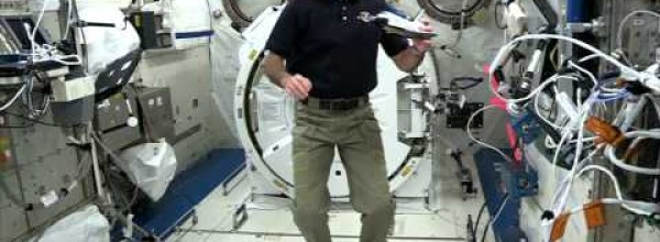 Station Astronauts Do Experiment for 'Cosmos' 2