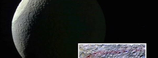 Scientists Found Mysterious Red Arcs on Tethys, Saturn's Icy Moon
