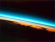 This photograph of the colorful layers of Earth's upper atmosphere was taken from the space shuttle, looking sideways across Earth's atmosphere. Image Credit: NASA